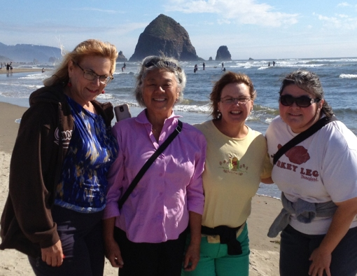 My choir sisters Susan (from left), Melissa, Anne-Marie, and me in pink under the iconic 235-foot Haystack Rock, Northern Oregon coast.