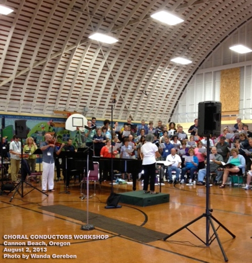 Me, conducting the dress rehearsal on the day of performance with violin, percussionists, soloist, and choir. Half of the choir and the soloist are not pictured. Cannon Beach School Gymnasium, Oregon.