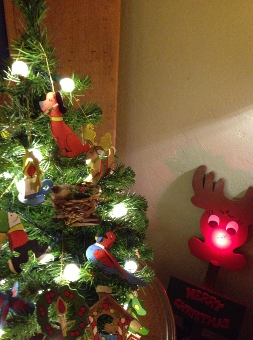 The wooden ornaments for the tree were made by Pete's parents for their granddaughter Ari. Dad made the big Rudolph with the shiny nose, too.