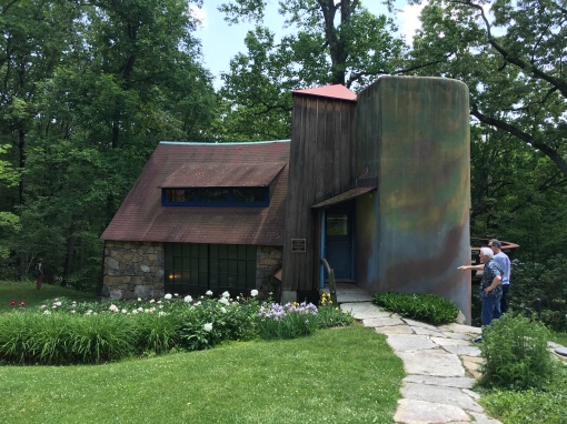Stone, wood, and stucco comprise three sections of the artist's studio built in increments as they were needed.