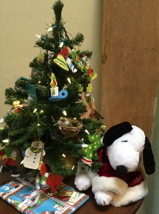 Our traditional tiny tree with wood ornaments plus a Snoopy theme this year